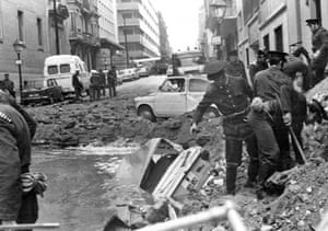 History of ETA: 1973: Spanish policemen search among the damage after a bomb attack