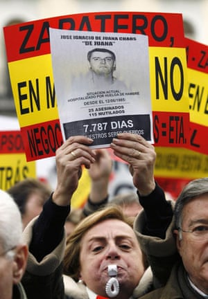 History of ETA: 2006: A woman holds a picture of a member of ETA during a demonstration