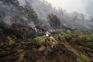 24 hours: El Arenal, Spain: Residents of  try to extinguish a wild fire