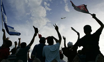 Zelaya supporters cheer his plane, which was prevented from landing in Honduras.