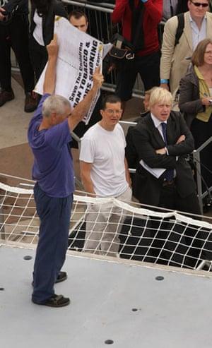 Trafalgar Square plinth: Anti-smoking protester Stuart Holmes is watched by artist Antony Gormley