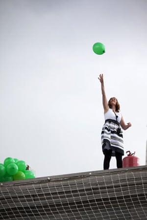 Trafalgar plinth: Jill Gatcum releases a balloon as she stands on the fourth plinth