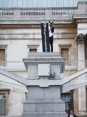 Plinth Trafalgar Square: Suren Seneviratne stands on the empty fourth plinth with his mobile phone