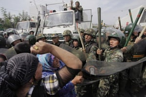 Uighurs protest: Protest by Uighurs against a line of security forces