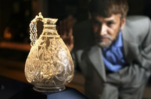 Jameel prize: Dr Bari examines a rock crystal ewer at the Victoria & Albert Museum