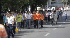 Urumqi riots: Han Chinese vigilantes take to the streets armed with sticks