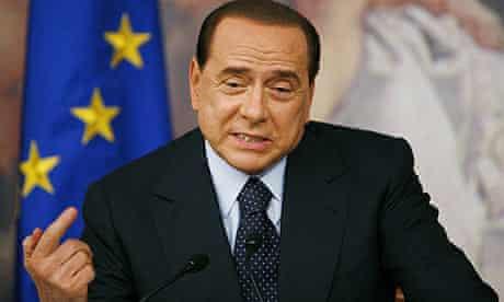 Silvio Berlusconi addresses a news conference in Rome