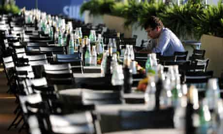 A journalist sits at a table at the G8 media centre on the eve of the G8 summit in L'Aquila.