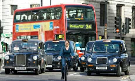Bike Blog: Clyclist in front of taxis and buses
