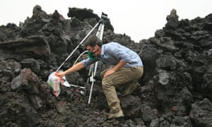 David Ferguson collects samples from a lava flow