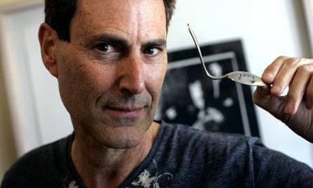 Israeli magician Uri Geller with bent spoon