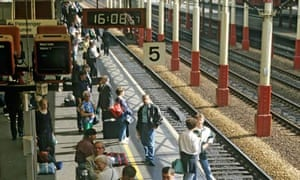 Passengers waiting on platform for train to arrive