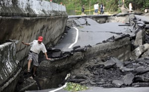 Typhoon Morakot aftermath: Tainan, Taiwan: A man walks on a damaged road