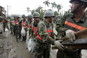 Typhoon Morakot aftermath: Cishan, Taiwan: Military help elderly residents remove debris