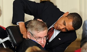 Stephen Hawking receives his presidential medal of freedom from the US president, Barack Obama