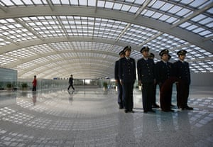 Airport design: Guards at the $3.6bn new terminal at Beijing airport