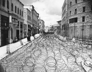 Israel-Palestine timeline: 1947-49. Barbed wire covers Princess Mary Avenue in Jerusalem
