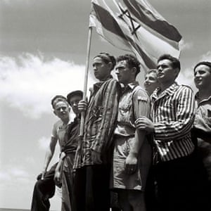 Israel-Palestine timeline: 1930. Jewish survivors of the Buchenwald stand on the ship Mataroa