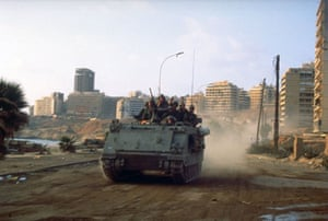 Israel-Palestine timeline: 1982. Israeli soldiers aboard APCs rumble through the streets of Beirut