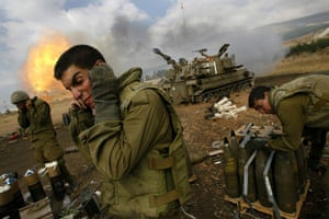 Israel-Palestine timeline: 2006. Israeli soldiers cover their ears as an artillery unit fires shells
