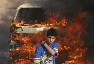 Israel-Palestine timeline: 2007. A Palestinian youth during clashes between Fatah and Hamas in Gaza
