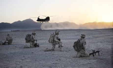 A Chinook helicopter approaches British troops during Operation Tyruna in Afghanistan