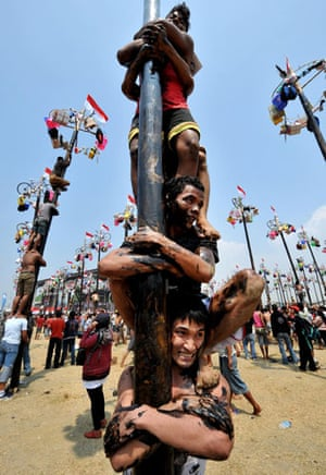 Jakarta independence day: People climb greased betel poles