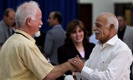 Uri Davis, left, at a Fatah meeting in Ramallah