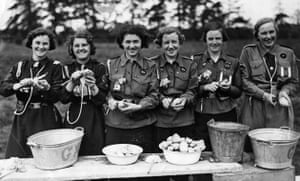 Girl guides 100th: Girl Guides in their camp, peeling potatoes 1938