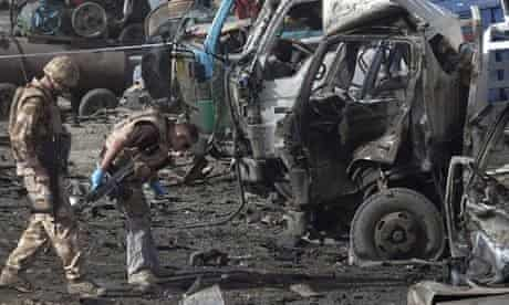 British soldiers survey the site of a bomb blast in Kabul