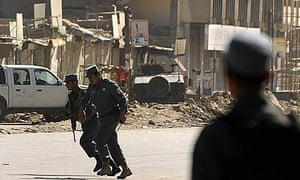 Police outside a bank building that was stormed by gunmen in Kabul