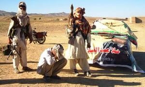 Taliban fighters detain a man for campaigning in elections in Afghanistan