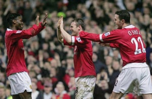 Wayne Rooney Top Ten: Wayne Rooney celebrates with Evra and O'Shea after scoring his first goal