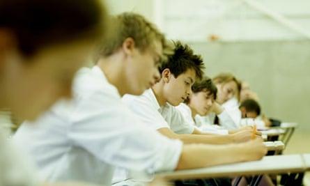 School children taking exam