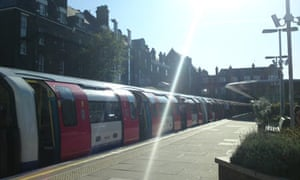 A London Underground tube train arrives at West Hampstead station in London. Photograph: Paul Owen.