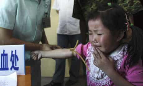 Child has blood sample taken for examination of lead levels in blood at hospital in Wugang