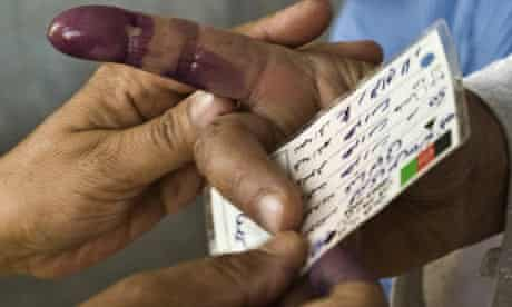 An Afghan woman's ink-dipped finger after showing her identity card to vote