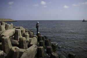 Nile Delta:  Said Mohamed Shairwi fishes from the wall built to prevent coastal erosion