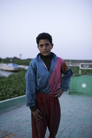 Nile Delta: A young child who works on the fishing boats on Lake Burullus