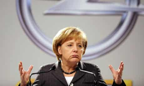 Angela Merkel gives a speech at an Opel car manufacturing plant in Ruesselsheim, western Germany