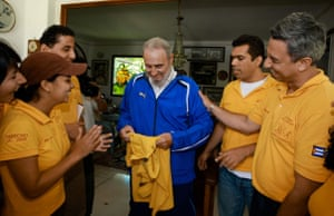 Tracksuits: Cuban leader Fidel Castro in a tracksuit smiles as he receives a gift