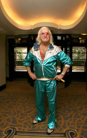 Tracksuits: Jimmy Savile wearing a shiny green Nike shellsuit
