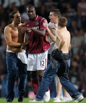 West Ham v Millwall: West Ham's Carlton Cole reacts to fans during a pitch invasion