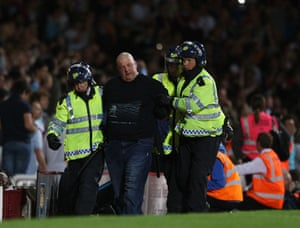 West Ham v Millwall: A fan gets lead away by riot police at Upton Park