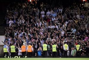 West Ham v Millwall: Stewards stand infront of the Millwall fans who taunt the West Ham fans.