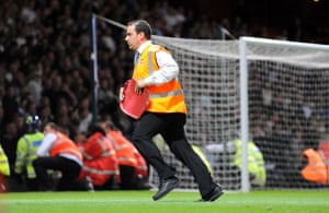 West Ham v Millwall: A steward removes a broken seat from the pitch