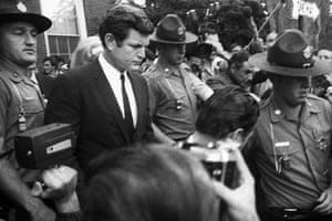Edward Kennedy: 1969: Edward Kennedy is escorted by troopers