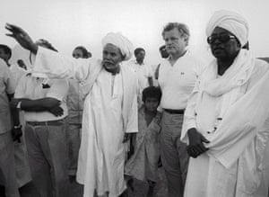 Edward Kennedy: 1984: Ted Kennedy with his arm around a Sudanese boy
