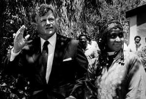 Edward Kennedy: 1985: Edward Kennedy walks next to Winnie Mandela in Brandfort