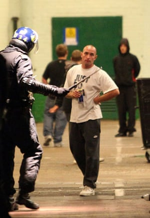 west ham millwall: A man confronts riot police outside Upton Park